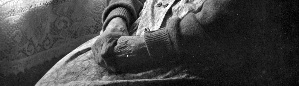 An old woman's hands folded in her lap